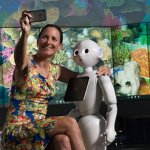 Researcher with first humanoid robot that can recognise emotions