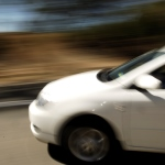 Blurred image of part of a speeding car